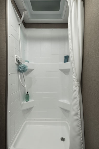 RV showers need to be larger to accommodate larger travelers.